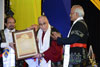 The Dalai Lama being awarded the Honorary  Degree of Doctor of Philosophy at the MLCU Convocation