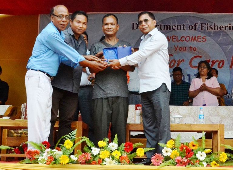 Chief Minister Dr Mukul Sangma awards the best fish santuary to Wachi Wari, Rombagre during the Aquafest 2017 at Tura