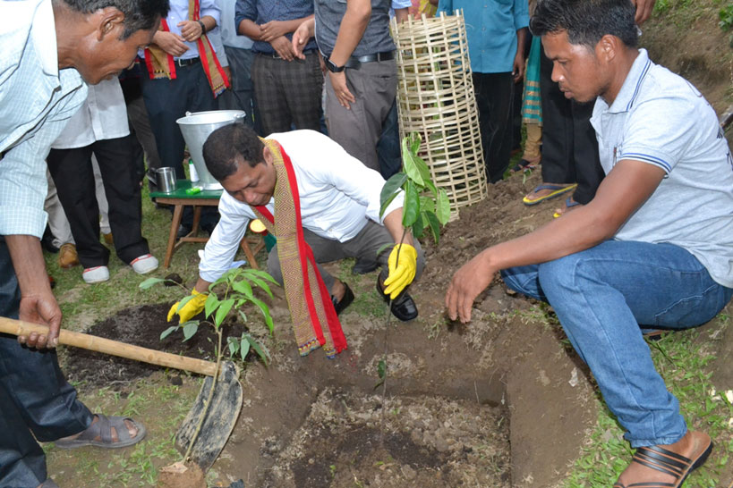 CM Dr Mukul Sangma plants a tree sapling during the launch of My Village Model Village at Garagre