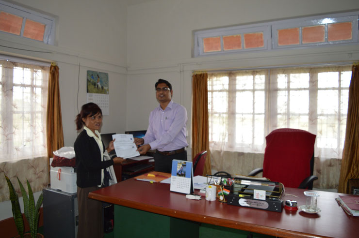 Ankit Kumar Singh, SDO (C) Sohra Sub Division handing over the ST Certificate to the first applicant after the successfull roll out of the e-Services at the Office of the SDO (C), Sohra