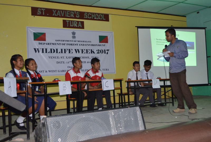 Students of various schools of Tura town participating in the quiz competition held during the Wildlife Week celebration