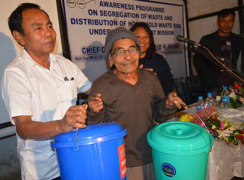 Parliamentary Secy incharge Urban Affairs, Noverfield Marak distributing Household Bins to residents of Akonggre locality