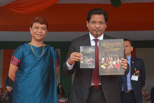 Chief Minister, Shri Conrad K Sangma releasing the Coffee Table Book titled 'Meghalaya Close to the Hearth' on the occasion of the 73rd Independence Day Celebration on 15th August, 2019