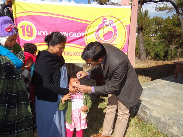 Shri. S Goyal, IAS, Deputy Commissioner, Shillong administered polio drops to one of the children at the booth