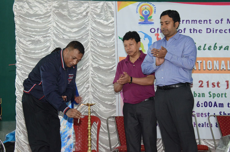 Health & Family Welfare Minister, Shri A. L. Hek lighting the ceremonial lamp to mark the celebration of 4th International Day of Yoga at Laban Sports Club, Shillong on 21-06-2018