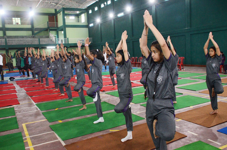Participants doing yoga exercises during the 4th International Day of Yoga at Laban Sports Club, Shillong on 21-06-2018