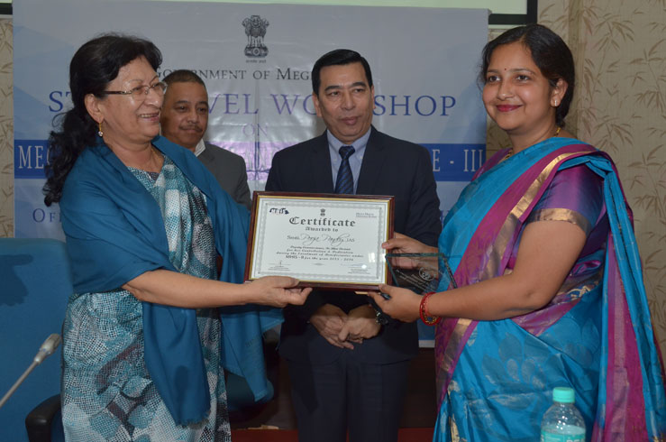 Health Minister Smt.Roshan Warjri handing an award during the State level Workshop on MHIS-Phase III