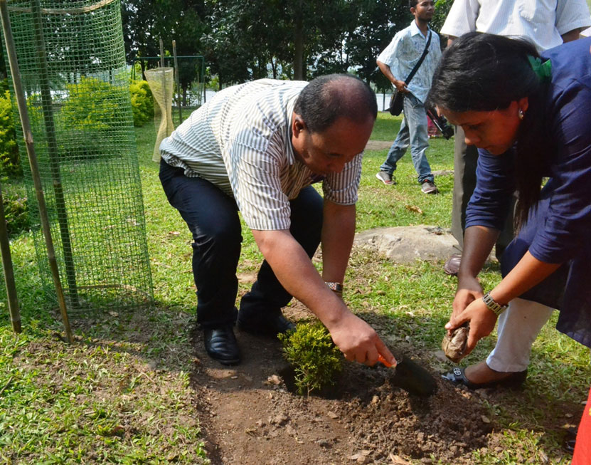Conservator of Forests, SF, GH Region, P R Marak plants saplings during the International Biodiversity Day celebration