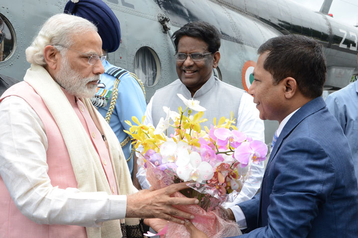 Prime Minster Narendra Modi being received by Dr.Mukul Sangma, Chief Minister of Meghalaya, V.Shanmuganathan, Governor of Meghalaya and other dignitaries at the ALG, Upper Shillong