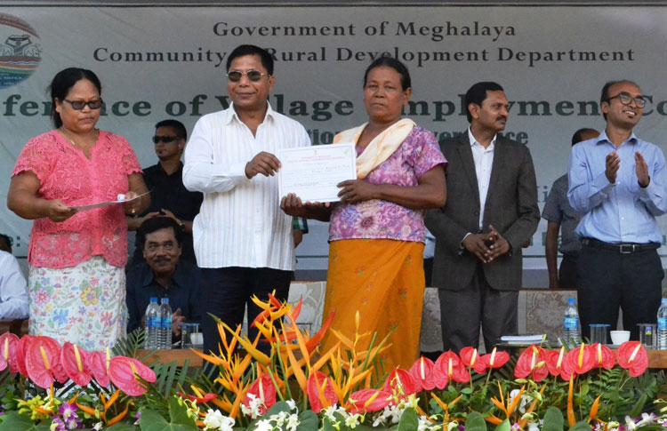 CM Dr Mukul Sangma presents awards to best performing fair price shop dealers during the conference of VECs
