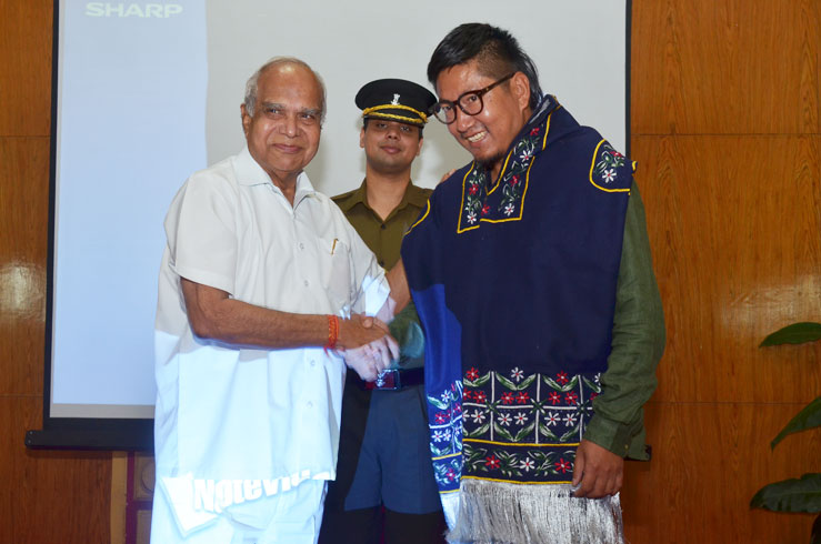 Governor of Meghalaya Shri Banwarilal Purohit felicitating the director of the Documentary film My name is Eeooow Oinam Doren